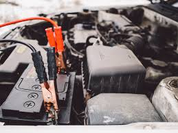 Car battery and jumper cables in the winter in Rapid City, South Dakota.